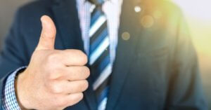 close-up-photo-of-man-wearing-black-suit-jacket-doing-thumbs
